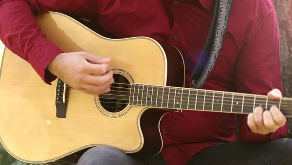 Close-up view of man hands playing acoustic guitar Royalty-free stock video