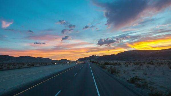Hyperlapse of a road in a desert at sunset Rights-managed stock video