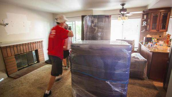 Timelapse shot of movers packing up furniture Rights-managed stock video