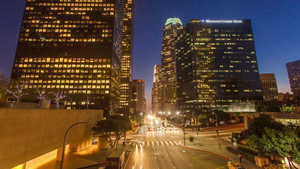 DOWNTOWN, LOS ANGELES, CALIFORNIA, USA - 29 SEPTEMBER 2014, Hyperlapse video view on sunset over buildings and street traffic. Transition from day to night. Trademarks removed. Royalty-free stock video
