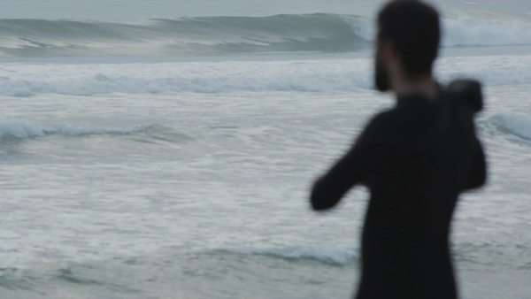 Waves in focus as surfer gets ready Royalty-free stock video