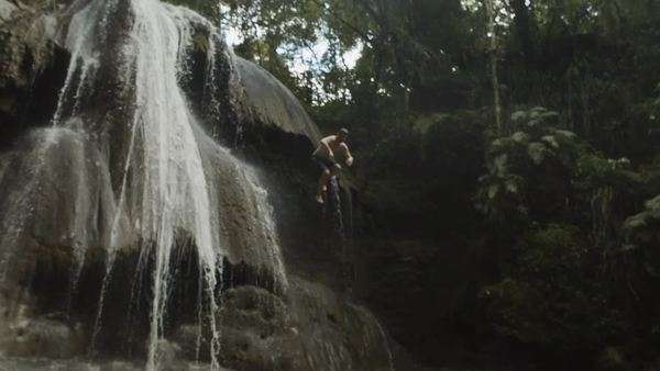 Man jumps off waterfall Royalty-free stock video