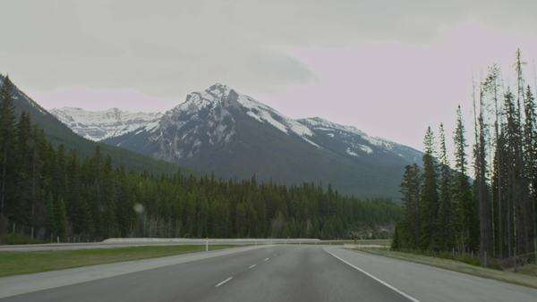 Driving through tunnel revealing mountains Royalty-free stock video
