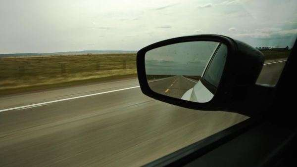 Pov looking at rearview mirror driving in countryside Royalty-free stock video