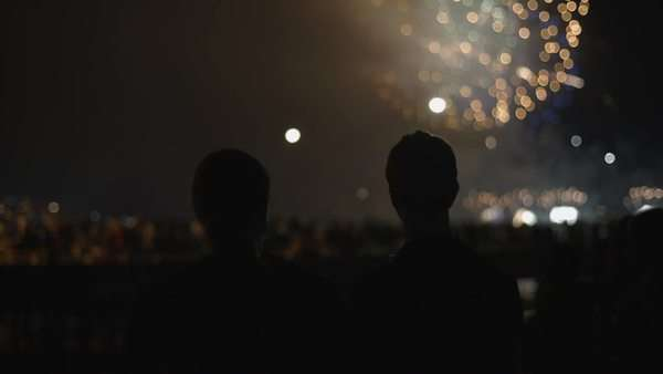 A couple watches fireworks in the distance Royalty-free stock video
