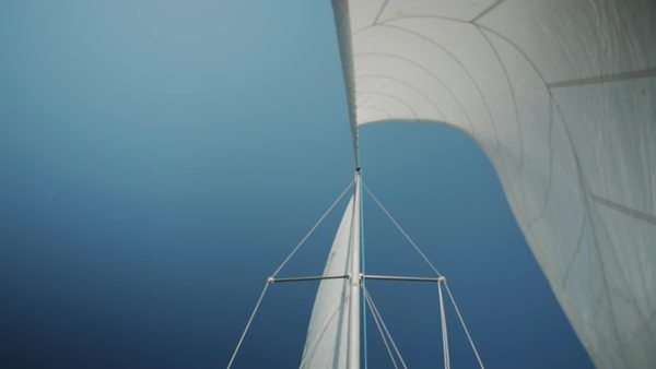 Sail whips in wind against blue sky Royalty-free stock video