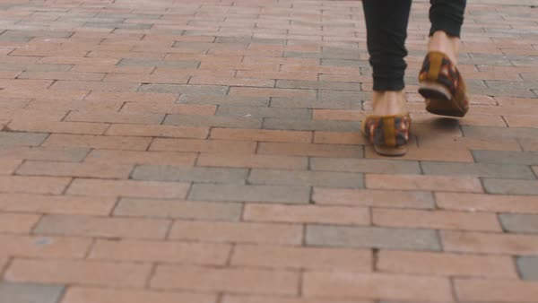 Shoes walking in slow motion along brick walkway Royalty-free stock video