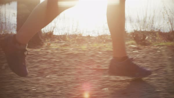 Feet running on a trail with lens flares Royalty-free stock video