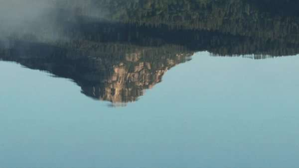 A reflection of mountain in water Royalty-free stock video