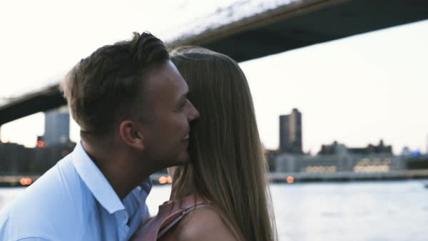 Arc shot of a couple dancing along East River Royalty-free stock video