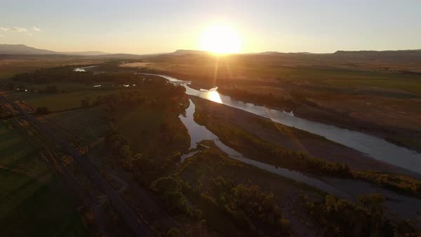 Aerial of river and field at sunset Royalty-free stock video