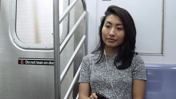 Hand-held shot of a woman sitting in a subway train Royalty-free stock video