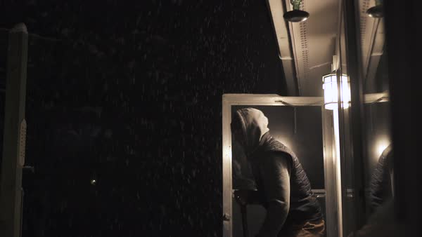 Tilt shot of a man shoveling snow at night Royalty-free stock video