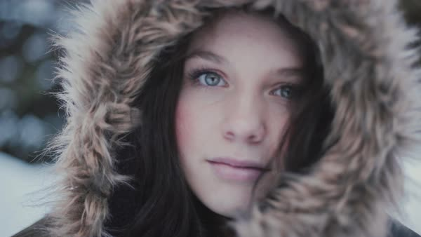Hand-held shot of an attractive woman in a hooded jacket Royalty-free stock video
