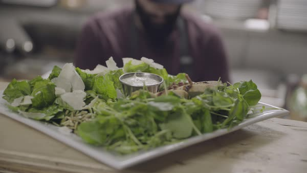 Hand-held shot view of a plate of food in a restaurant Royalty-free stock video