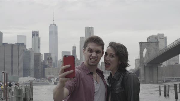 Hand-held shot of a young couple taking a selfie in New York Royalty-free stock video