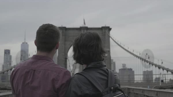 Back view shot of a couple standing on Brooklyn Bridge Royalty-free stock video