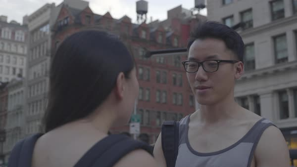 Gimbal shot of a man and a woman talking on a street in New York City Royalty-free stock video