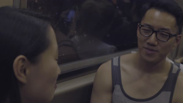 Hand-held shot of a young couple talking in a subway train Royalty-free stock video