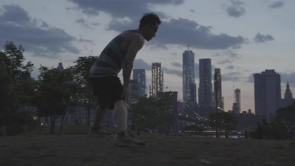 Cinematic shot of young man working out in a park Royalty-free stock video