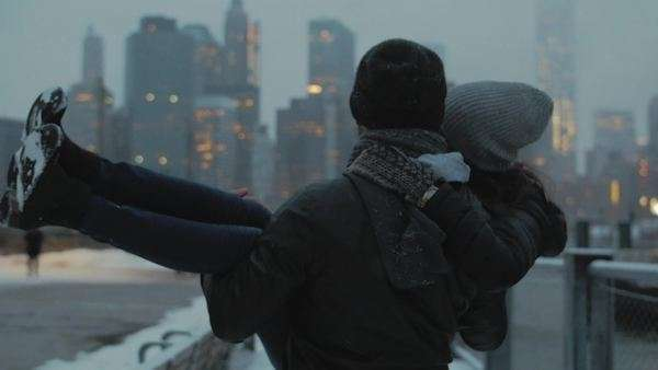 Cinematic shot of young romantic couple holding each other with Manhattan skyline in background Royalty-free stock video