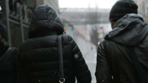Cinematic shot of young attractive couple walking the streets of New York City while snowing Royalty-free stock video
