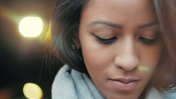 Close-up backlit shot of beautiful young woman looking down Royalty-free stock video