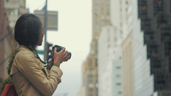 Attractive woman taking photos on streets of New York City Royalty-free stock video