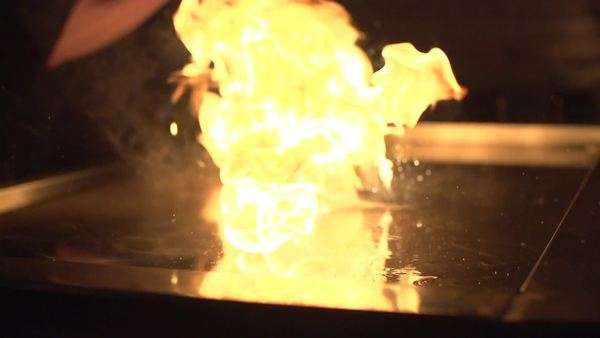 Slow motion shot of food sliding on a griddle stove Royalty-free stock video