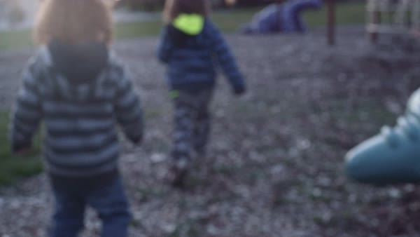 Close up shot of young boys running in a park Royalty-free stock video