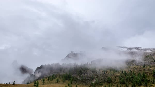 Timelapse of clouds moving over mountain and trees Royalty-free stock video