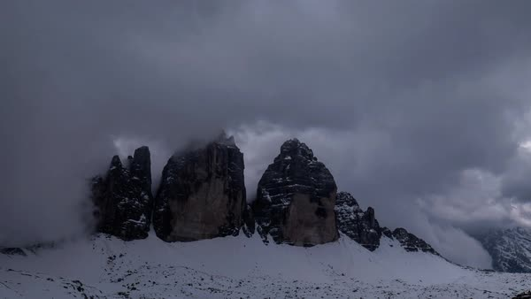Timelapse of clouds moving over snow covered Tre Cime di Lavaredo mountain Royalty-free stock video