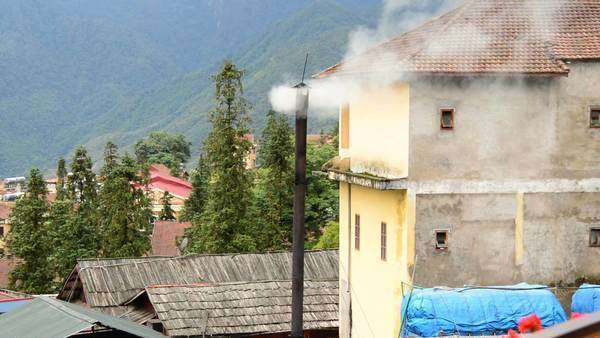 Sapa Vietnam  - Smoke Rises from Vent on a Rooftop Royalty-free stock video