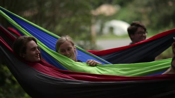 Playful Group Of Friends (Early 20s) Relax And Hang Out In Hammocks At Campground  Royalty-free stock video
