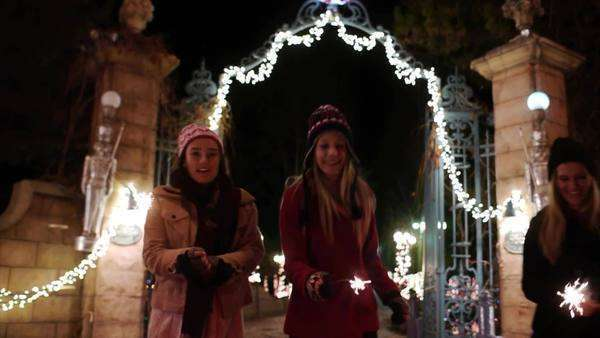 Teen Girls w/Sparklers In Winter Wonderland Walk Up For Close Up Portrait–Slow Mo Royalty-free stock video