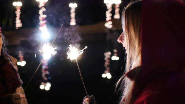 Teen Laughing Girls With Sparklers During The Winter Holidays Royalty-free stock video