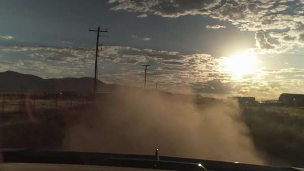 Dust Rising Behind A Car Flying Down On A Dirt Road Royalty-free stock video