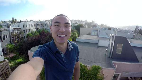 Happy asian man takes a selfie on a rooftop in San Francisco Royalty-free stock video
