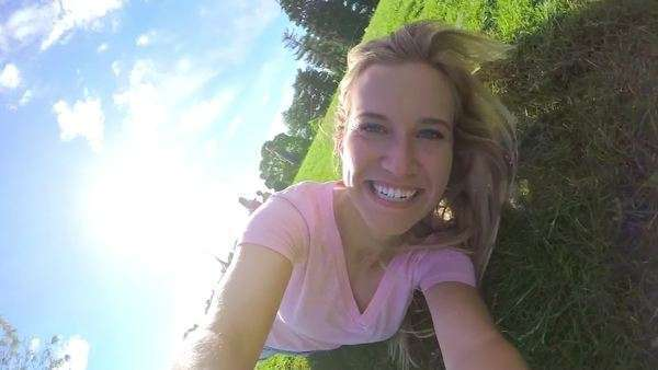 Happy teenage girl rolls down a big hill, slow motion Royalty-free stock video