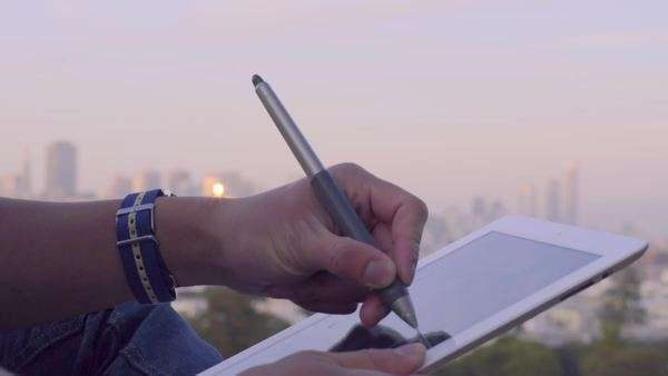 Close-up of man's hands as he sketches on a tablet Royalty-free stock video
