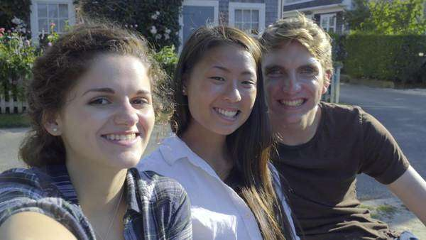 Group of fun multiethnic teens pose for selfies on summer vacation on Nantucket island, they make faces/peace signs/thumbs up Royalty-free stock video