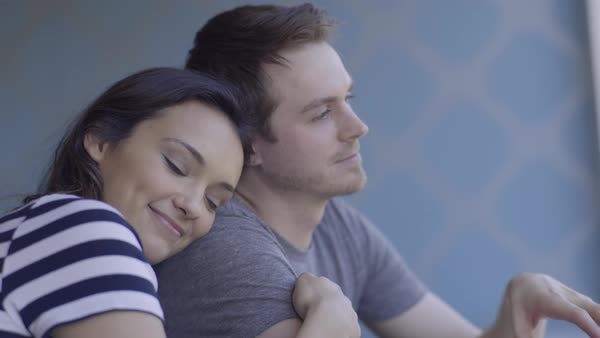 Closeup Of Happy Couple, Multi Ethnic Woman Embraces Her Boyfriend And Looks Out Window At View Royalty-free stock video