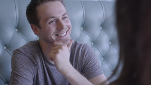 Closeup Of Man Talking And Laughing With His Girlfriend At A Restaurant Royalty-free stock video
