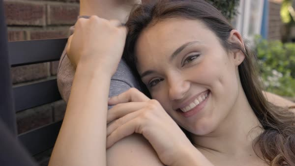Closeup Of Beautiful Mixed Race Woman Cuddling With Her Boyfriend While They Wait To Be Seated At Restaurant Royalty-free stock video