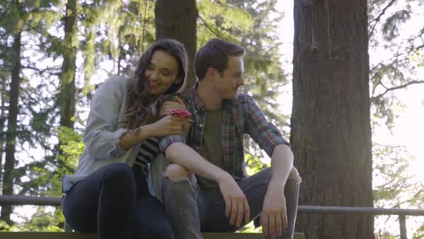 Happy Couple Cuddle On A Picnic Table In The Woods (Slow Motion) Royalty-free stock video