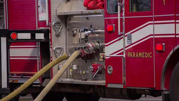 Fire Truck hoses coming out of fire truck pumping water on a fire Royalty-free stock video
