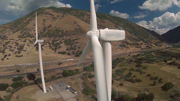 Wind turbines spinning from wind power generating electricity in canyon of mountains Royalty-free stock video