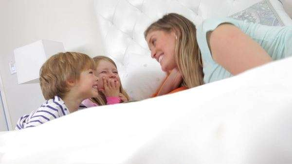 Family lying on bed reading books together. Royalty-free stock video