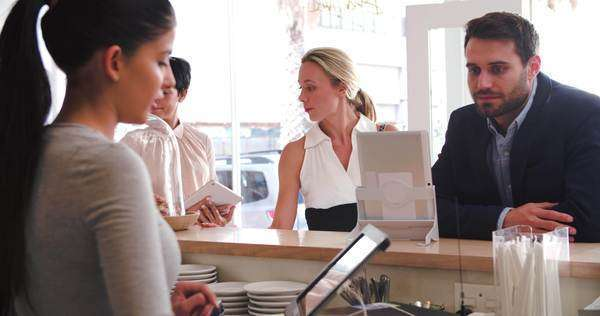 Customers ordering and paying at the counter in a cafe Royalty-free stock video