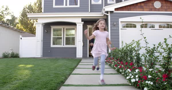 Family coming out of front door of suburban home Royalty-free stock video